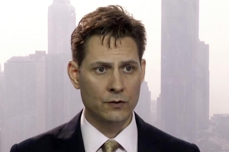 """FILE - In this March 28, 2018, file image made from video, Michael Kovrig, an adviser with the International Crisis Group, a Brussels-based non-governmental organization, speaks during an interview in Hong Kong. China told Prime Minister Justin Trudeau on Monday, June 22, 2020 to """"stop making irresponsible remarks"""" after he said Beijing's decision to charge two Canadians with spying was linked to his country's arrest of a Chinese tech executive. (AP Photo, File)"""