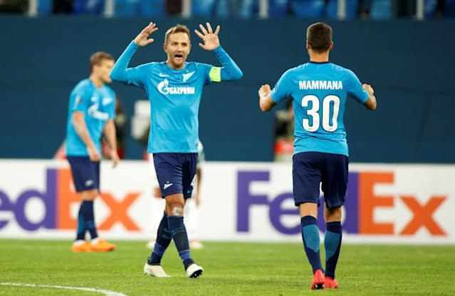 Soccer Football - Europa League Round of 32 Second Leg - Zenit Saint Petersburg vs Celtic - Stadium St. Petersburg, Saint Petersburg, Russia - February 22, 2018 Zenit St. Petersburg's Domenico Criscito and Emanuel Mammana celebrate after the match REUTERS/Anton Vaganov