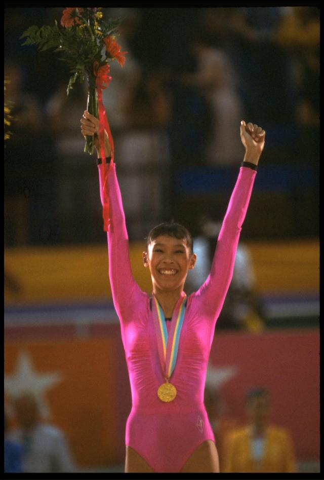 11 AUGUST 1984: LORI FUNG OF CANADA WINS THE GOLD MEDAL IN THE INAUGURAL RHYTHMIC ALL-AROUND GYMNASTICS AT THE 1984 LOS ANGELES OLYMPICS. FUNG WINS WITH A TOTAL POINTS SCORE OF 57.95 POINTS.