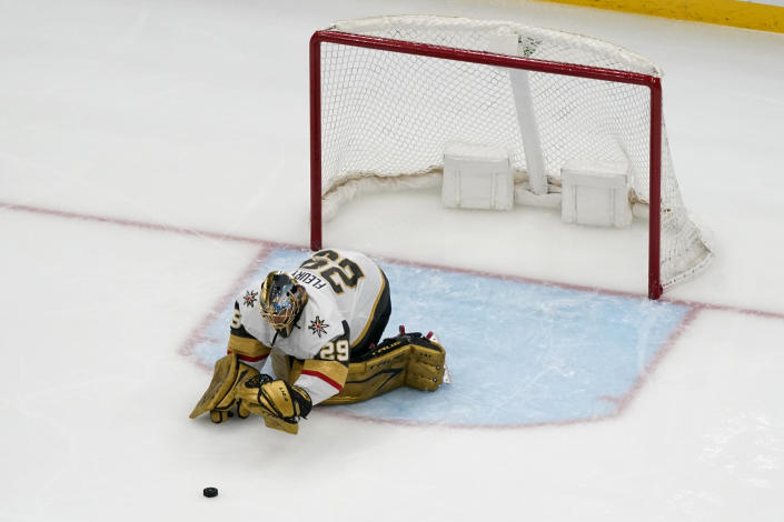 Vegas Golden Knights goaltender Marc-Andre Fleury stops a puck with his gloves after losing his stick during the third period of an NHL hockey game against the St. Louis Blues Wednesday, April 7, 2021, in St. Louis. (AP Photo/Jeff Roberson)