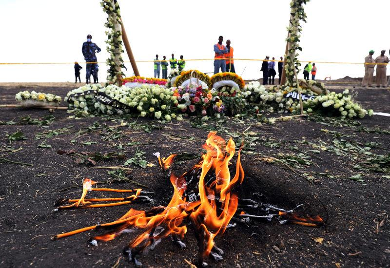 FILE PHOTO: Candle flames burn during a commemoration ceremony for the victims at the scene of the Ethiopian Airlines Flight ET 302 plane crash, near the town Bishoftu