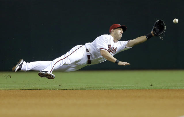 Arizona Diamondbacks' Willie Bloomquist can't stop a ball from dropping for a base hit by Miami Marlins' Logan Morrison during the fourth inning of a baseball game, Tuesday, June 18, 2013, in Phoenix. (AP Photo/Matt York)