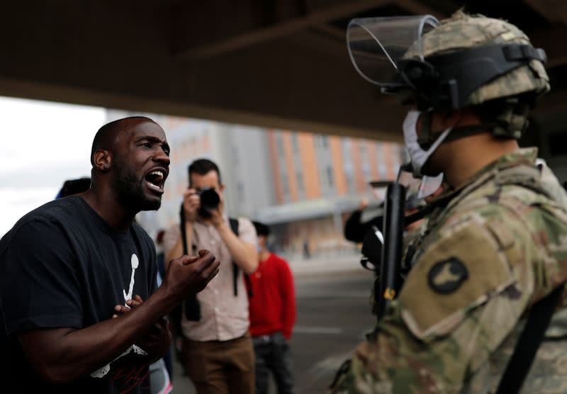 Man confronts a National Guard member guarding the area in the aftermath of a protest in Minneapolis
