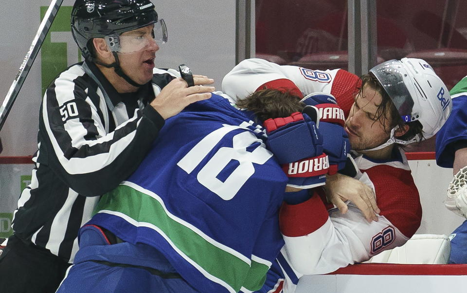 Vancouver Canucks right wing Jake Virtanen (18) tussles with Montreal Canadiens defenseman Ben Chiarot (8) during the first period of an NHL hockey game Thursday, Jan. 21, 2021, in Vancouver, British Columbia. (Jonathan Hayward/The Canadian Press via AP)
