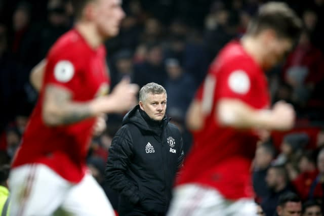 Ole Gunnar Solskjaer, centre, watches on as United were well beaten at home (Martin Rickett/PA)