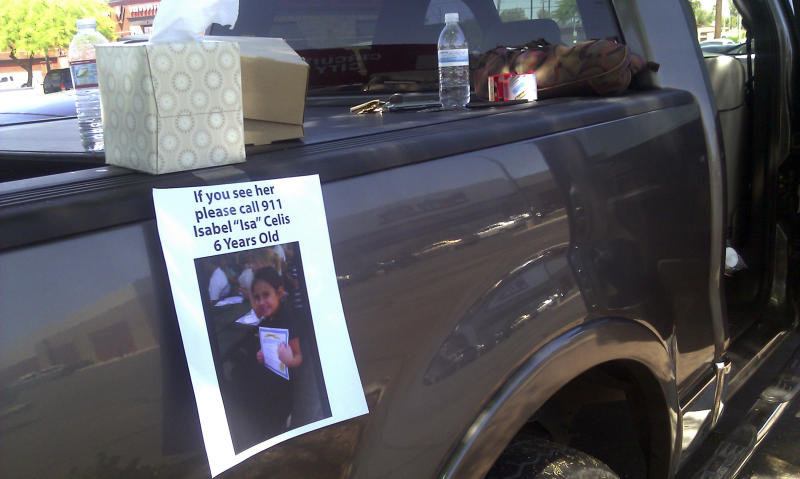 FILE - In this April 22, 2012, file photo, a flyer for missing 6-year-old Isabel Celis is placed on a volunteer's car in Tucson, Ariz. Tucson police Chief Chris Magnus says remains found in a remote area in Pima County about a month ago are those of Celis, who went missing from her family home nearly five years ago. Magnus said Friday, March 31, 2017, that an independent lab identified the remains as those of Celis. He said an investigation is ongoing but would not say whether there were any new suspects. (AP Photo/Terry Tang, File)