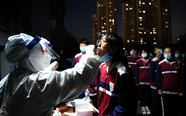 A mass testing programme was quickly rolled out following an outbreak in Qingdao - Reuters