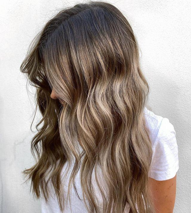 """<p>It's definitely on the warmer side, but this ash """"<a href=""""https://www.cosmopolitan.com/style-beauty/beauty/news/a52843/cinnamon-swirl-new-hair-color-technique/"""" rel=""""nofollow noopener"""" target=""""_blank"""" data-ylk=""""slk:bronde"""" class=""""link rapid-noclick-resp"""">bronde</a>"""" hair is a great option for folks who want something in between blonde and brown. TBH, this is a <strong>great color for transitioning out of winter.</strong></p><p><a href=""""https://www.instagram.com/p/B42jlGGJJw9/"""" rel=""""nofollow noopener"""" target=""""_blank"""" data-ylk=""""slk:See the original post on Instagram"""" class=""""link rapid-noclick-resp"""">See the original post on Instagram</a></p>"""