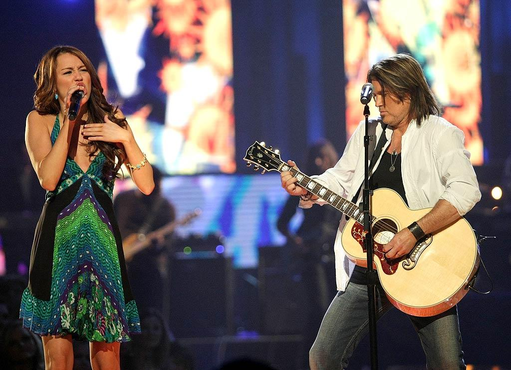 "Billy Ray's little girl, who was growing up fast, co-hosted the CMT Music Awards with him in April 2008. The two also sang together on the ditty ""Ready, Set, Don't Go."" Frank Micelotta/<a href=""http://www.gettyimages.com/"" target=""new"">GettyImages.com</a> - April 14, 2008"