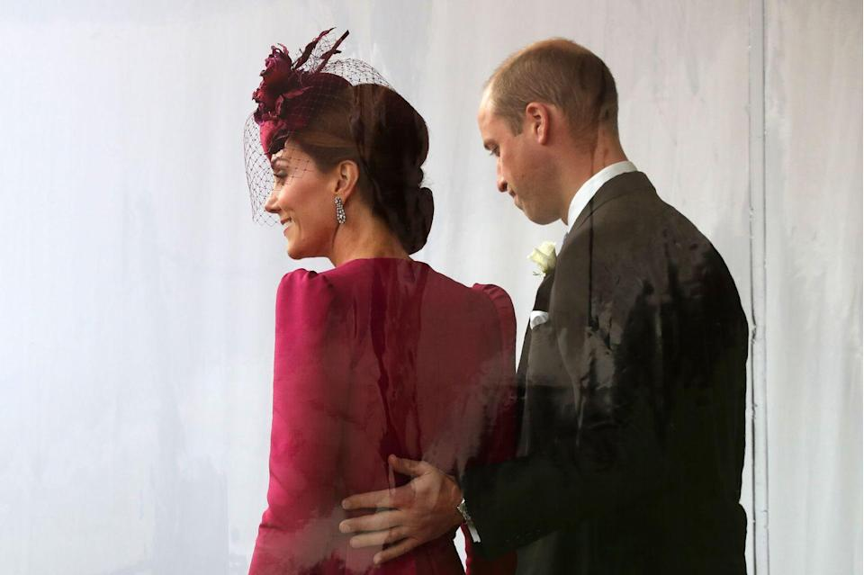 """<p>Prince William sweetly touches Kate's back at <a href=""""https://www.townandcountrymag.com/society/tradition/g23322735/princess-eugenie-jack-brooksbank-royal-wedding-photos/"""" rel=""""nofollow noopener"""" target=""""_blank"""" data-ylk=""""slk:Princess Eugenie and Jack Brooksbank's wedding."""" class=""""link rapid-noclick-resp"""">Princess Eugenie and Jack Brooksbank's wedding.</a><br></p>"""