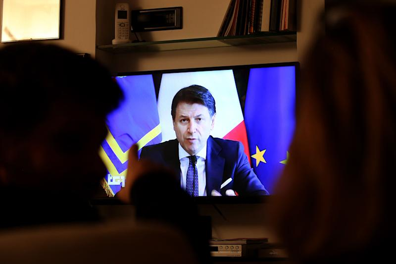 ROME, ITALY - MARCH 14: People watch tv as Italian Prime Minister Giuseppe Conte holds his speech on the new economic measures due to Coronavirus emergency on March 14, 2020 in Rome, Italy. (Photo by Franco Origlia/Getty Images) (Photo: Franco Origlia via Getty Images)