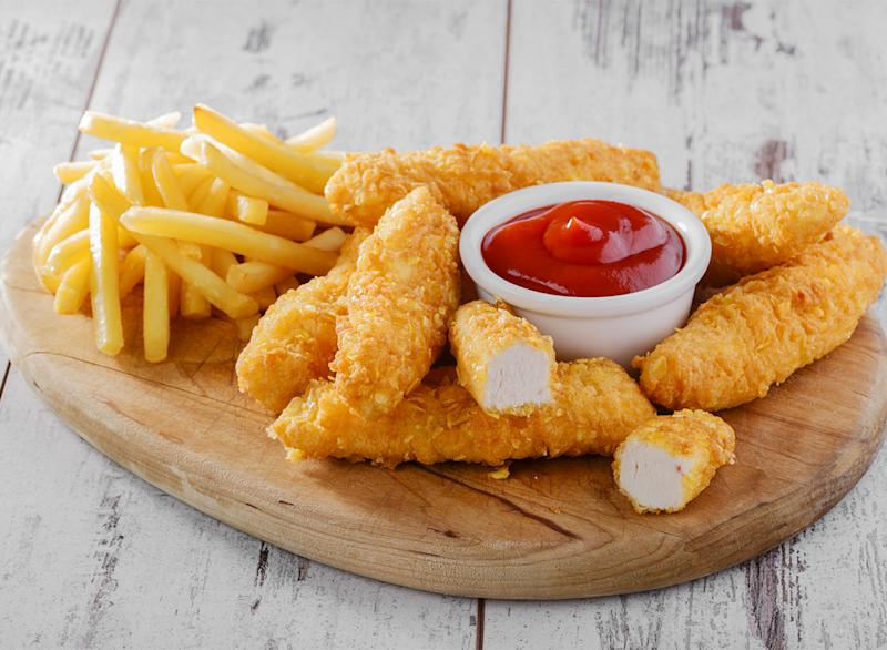 plate of chicken tenders and fries with ketchup