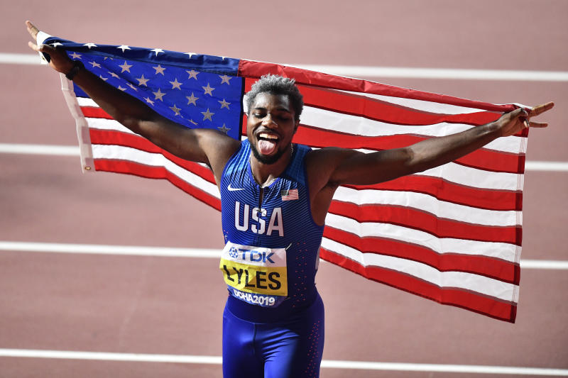 Noah Lyles of the U.S., celebrates winning a gold medal in the men's 200 meter final at the World Athletics Championships in Doha, Qatar, Tuesday, Oct. 1, 2019. (AP Photo/Martin Meissner)
