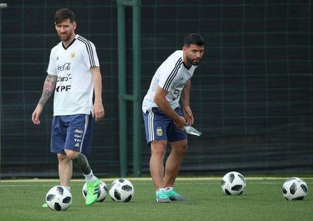 Soccer Football - FIFA World Cup - Argentina Training - Ciutat Esportiva Joan Gamper, Barcelona, Spain - June 6, 2018 Argentina's Sergio Aguero and Lionel Messi during training REUTERS/Albert Gea