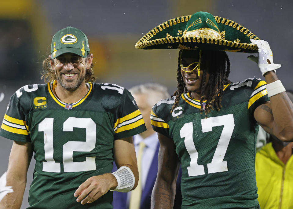 Green Bay Packers quarterback Aaron Rodgers (12) and receiver Davante Adams (17) had a lot of fun in Monday night's win. (AP Photo/Jeffrey Phelps)