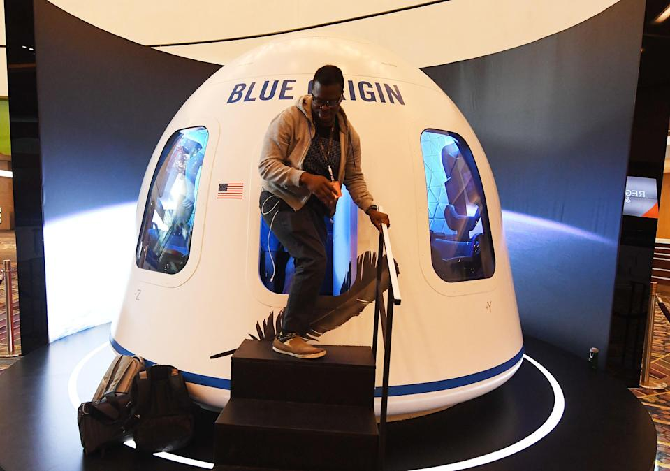 Participants leave the Blue Origin Space Simulator during the Amazon Re:MARS conference on robotics and artificial intelligence at the Aria Hotel in Las Vegas (AFP via Getty Images)