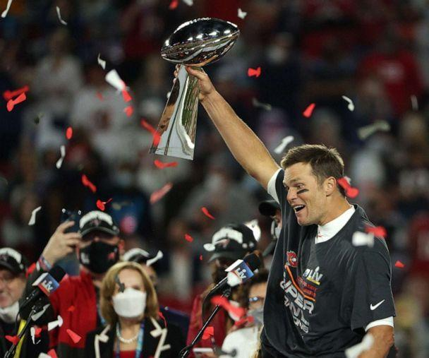 PHOTO: Tom Brady of the Tampa Bay Buccaneers hoists the Vince Lombardi Trophy after winning Super Bowl LV at Raymond James Stadium on Feb. 7, 2021 in Tampa, Fla. (Patrick Smith/Getty Images, FILE)