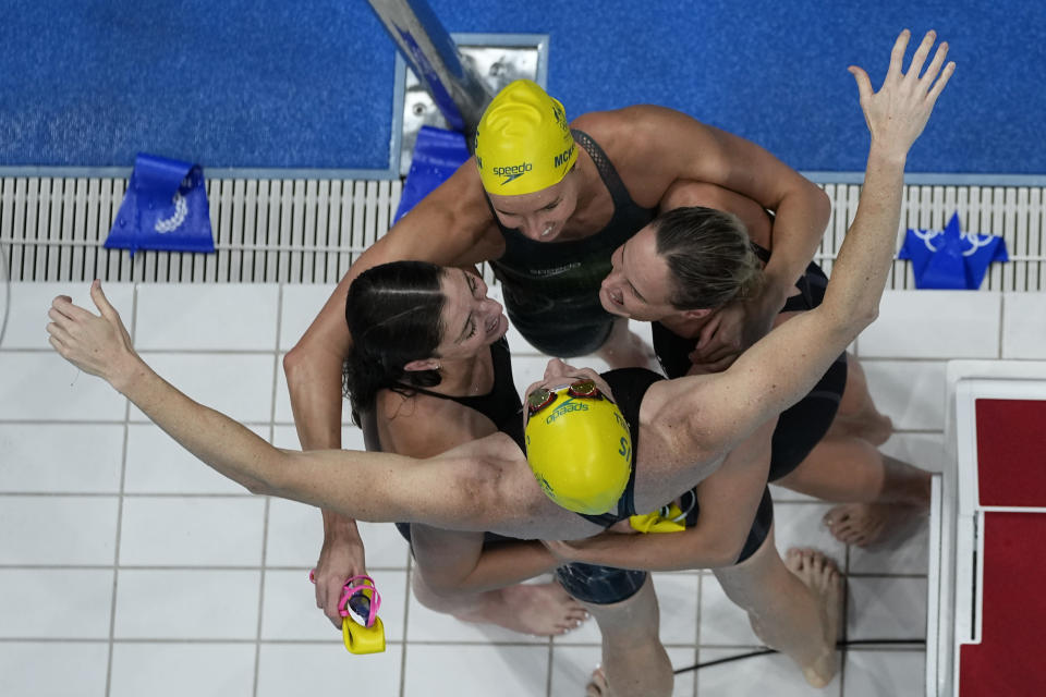 The team from Australia celebrates after winning the final of the women's 4x100m freestyle relay at the 2020 Summer Olympics, Sunday, July 25, 2021, in Tokyo, Japan. (AP Photo/Morry Gash)