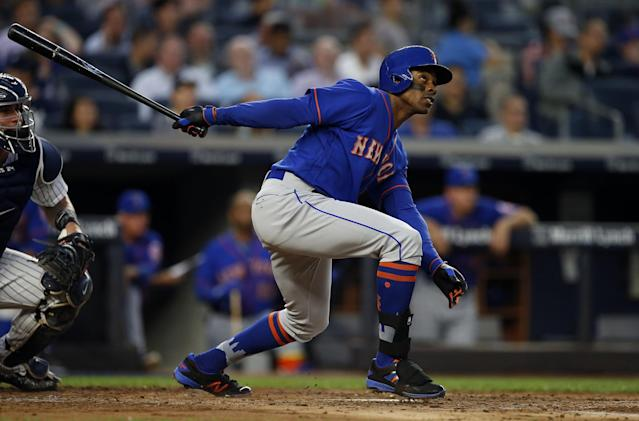 <p>New York Mets' Curtis Granderson hits a home run against the New York Yankees during the third inning of a baseball game Monday, Aug. 14, 2017, at Yankee Stadium in New York. (AP Photo/Rich Schultz) </p>