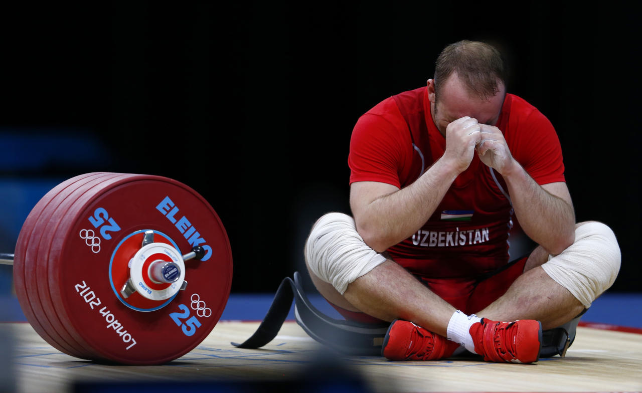 Uzbekistan's Ruslan Nurudinov reacts after failing a lift in the men's 105kg Group A weightlifting clean and jerk competition at the ExCel venue during the London 2012 Olympic Games August 6, 2012. REUTERS/Grigory Dukor (BRITAIN  - Tags: OLYMPICS SPORT WEIGHTLIFTING)