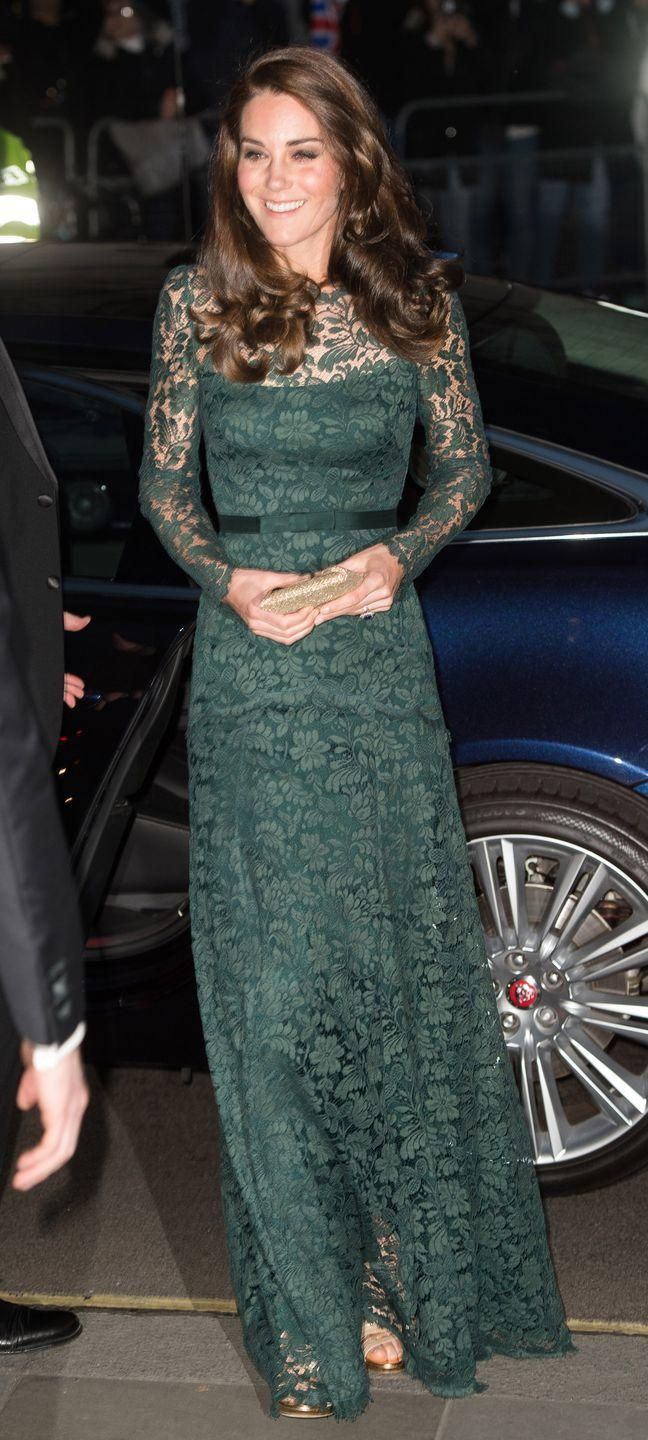 <p>In a green lace Temperly gown and gold heeled sandals at the National Portrait Gallery gala in London.</p>
