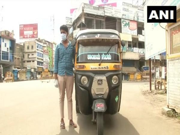 Akash Denur the young auto-rickshaw driver in Kalaburagi who offers free services amid the pandemic. (Photo/ANI)