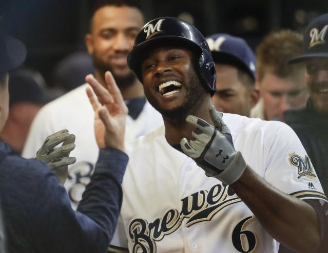 Milwaukee Brewers' Lorenzo Cain celebrates after hitting a home run during the sixth inning of a baseball game against the Arizona Diamondbacks Monday, May 21, 2018, in Milwaukee. (AP Photo/Morry Gash)