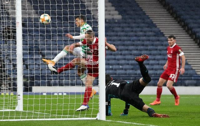 Mohamed Elyounoussi, left, scores Celtic's second goal on Sunday to edge them closer to a quadruple treble