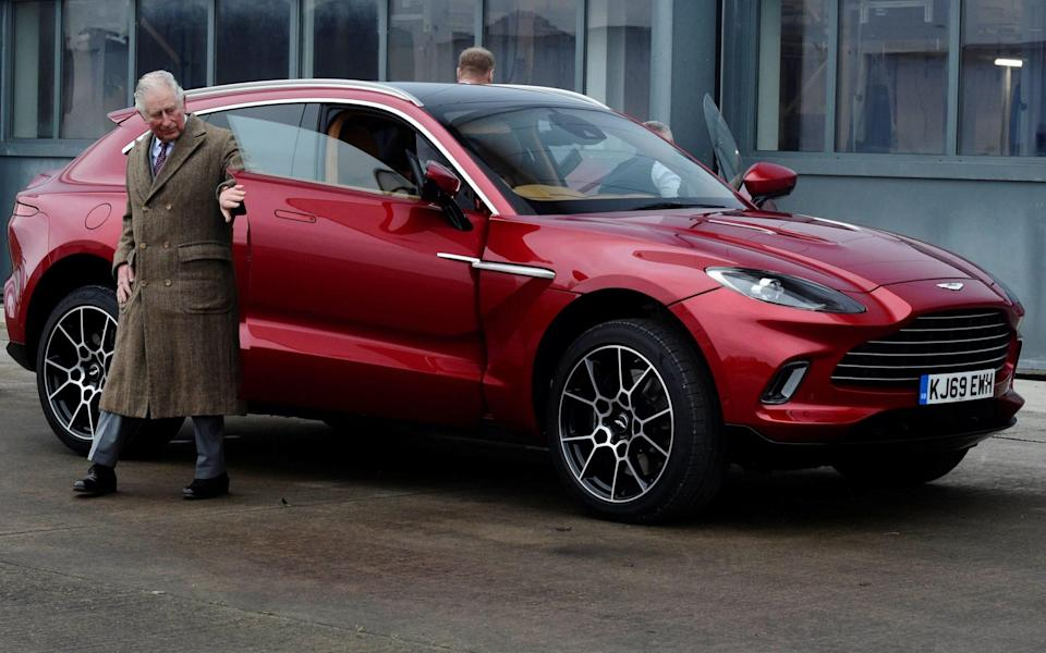 Prince Charles, Prince of Wales leaves the new Aston Martin DBX during a visit to the new Aston Martin Lagonda factory in Barry, Wales - REBECCA NADEN/AFP
