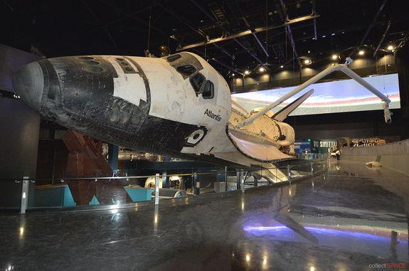 "— Space shuttle Atlantis is presented ""in flight"" inside its new $100 million display at NASA's Kennedy Space Center Visitor Complex in Florida. Atlantis' exhibit is set to open June 29, 2013."