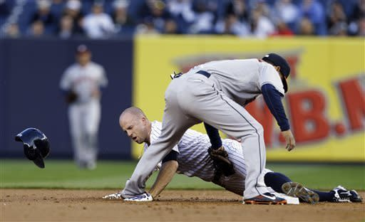 New York Yankees' Brett Gardner, bottom, safely steals second base ahead of the tag by Houston Astros shortstop Marwin Gonzalez in the first inning of a baseball game at Yankee Stadium in New York, Tuesday, April 30, 2013. (AP Photo/Kathy Willens)