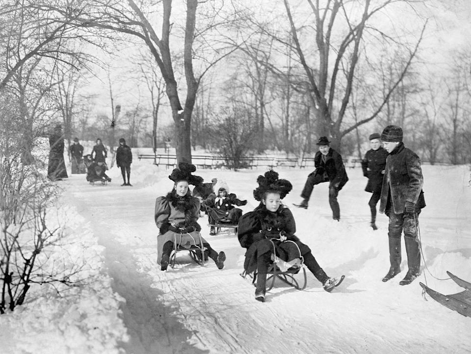 "Children sled down a snow-covered path in <a href=""https://www.cntraveler.com/activities/new-york/central-park?mbid=synd_yahoo_rss"" rel=""nofollow noopener"" target=""_blank"" data-ylk=""slk:Central Park"" class=""link rapid-noclick-resp"">Central Park</a>. The park's long and narrow design was the result of an 1858 competition won by Connecticut-born landscape architect Frederick Law Olmsted and British-American architect Calvert Vaux."