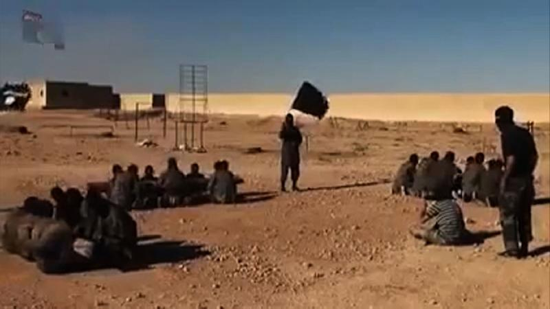 An image grab taken from a video released by Islamic State group's official Al-Raqqa site via YouTube on September 23, 2014, allegedly shows Islamic State (IS) group recruits at a training ground in an unknown location