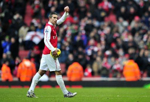 Robin van Persie, pictured here on February 4, has confirmed Arsenal's north London derby clash with Tottenham Hotspur will carry an extra edge by insisting it is a game Arsene Wenger's side simply cannot afford to lose