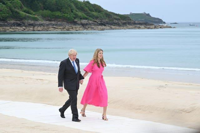 Prime Minister Boris Johnson and Carrie Johnson arrive for the leaders' official welcome and family photo during the G7 summit in Cornwall