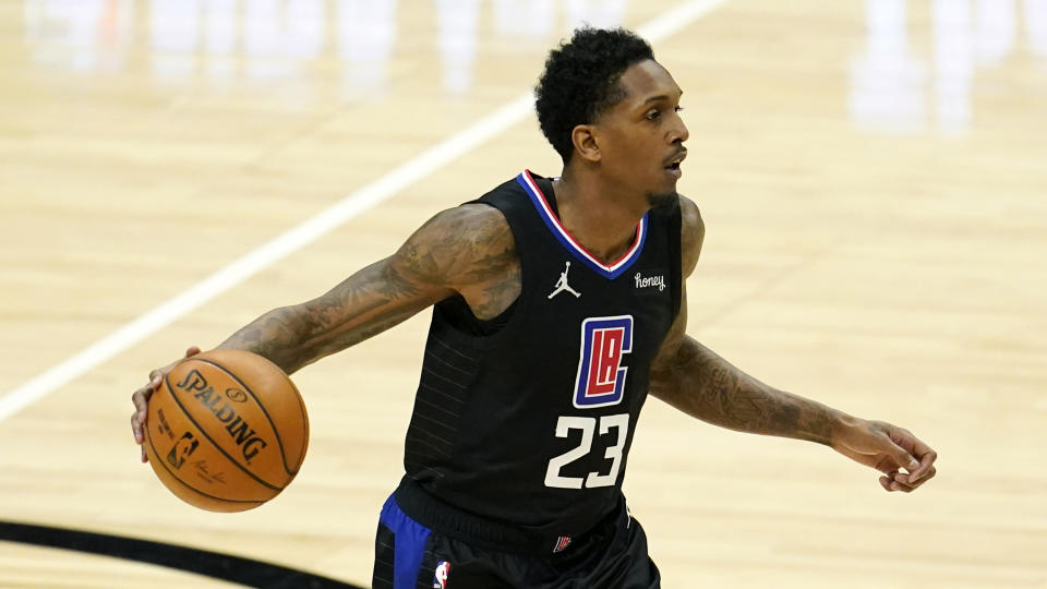 Los Angeles Clippers guard Lou Williams (23) dribbles during an NBA basketball game against the Golden State Warriors Thursday, March 11, 2021, in Los Angeles. (AP Photo/Marcio Jose Sanchez)