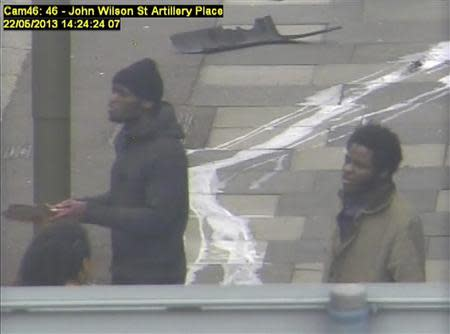 Michael Adebowale (R) and Michael Adebolajo speak to members of the public in Woolwich in this handout still image taken from May 22, 2013 CCTV footage by the Metropolitan Police, that was shown to the jury during the Lee Rigby murder trial at the Old Bailey in London December 3, 2013. REUTERS/Metropolitan Police/Handout via Reuters