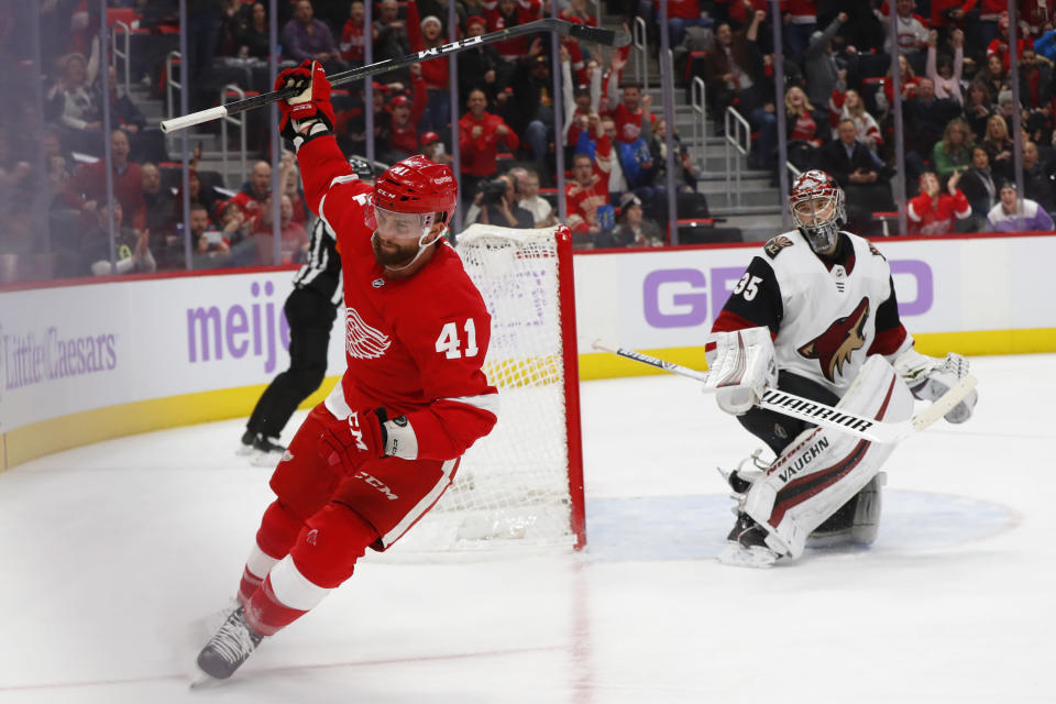 Detroit Red Wings center Luke Glendening (41) celebrates his goal against Arizona Coyotes goaltender Darcy Kuemper (35) in the second period of an NHL hockey game Tuesday, Nov. 13, 2018, in Detroit. (AP Photo/Paul Sancya)