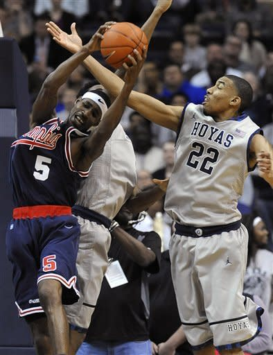 Memphis guard Will Barton (5) grabs a rebound away from Georgetown's Otto Porter (22) during second half of an NCAA college basketball game Thursday, Dec. 22, 2011, in Washington. Georgetown won 70-59. (AP Photo/Richard Lipski)