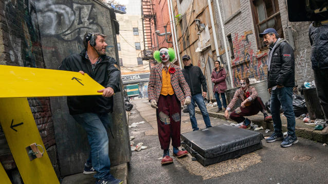 Cinematographer Lawrence Sher, Joaquin Phoenix and director Todd Phillips on the set of 'Joker'. (Credit: Niko Tavernise/Warner Bros)