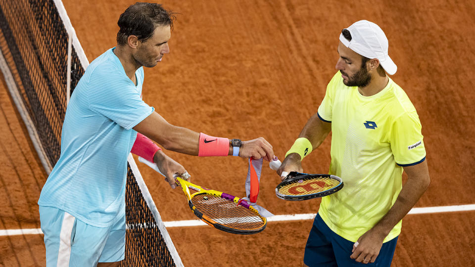 Rafael Nadal gives Stefano Travaglia the string dampener he had dropped, after beating him in the third round of the men's singles. (Photo by TPN/Getty Images)