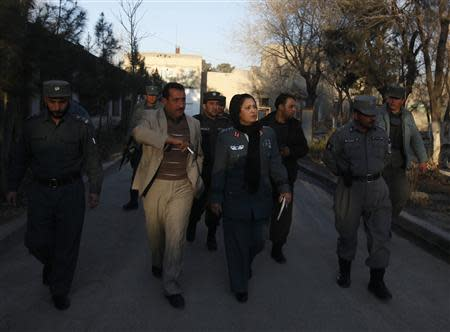 Colonel Jamila Bayaaz (C) walks after an interview in Kabul January 15, 2014. An Afghan policewoman took charge of a district in the capital Kabul this week, such an unusual and dangerous appointment in a country where women have few rights that her bosses gave her four bodyguards. REUTERS/Mohammad Ismail