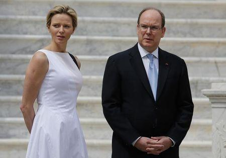 Prince Albert II of Monaco and his wife Princess Charlene wait for the arrival of Montenegro's President Filip Vujanovic and his wife Svetlana in the main courtyard of the Monaco Palace