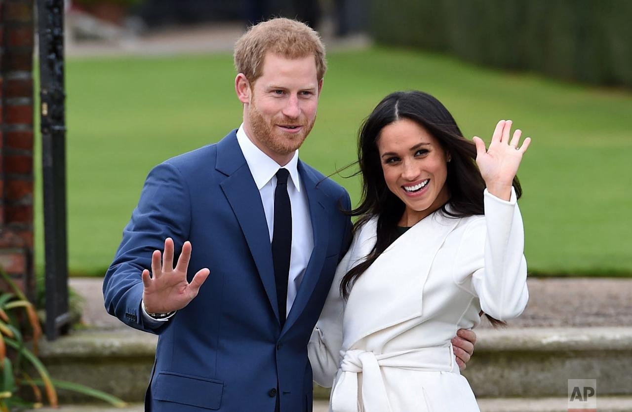 <p>Britain's Prince Harry and Meghan Markle pose for the media in the grounds of Kensington Palace in London. It was announced Monday that Prince Harry, fifth in line for the British throne, will marry American actress Meghan Markle in the spring, confirming months of rumors. (Eddie Mulholland/Pool via AP) </p>
