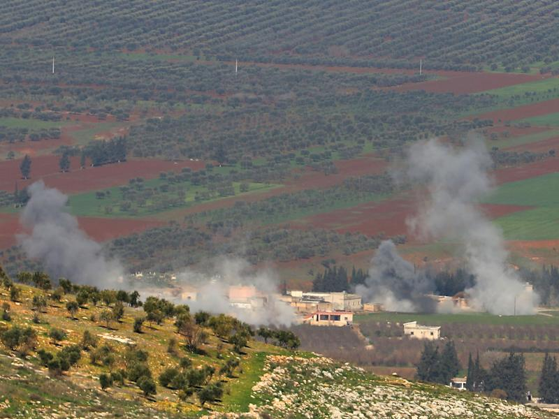Turkish-backed Syrian rebel fighters fire from the town of Salwah, less than 10 kilometres from the Syria-Turkey border, towards Kurdish forces from the People's Protection Units (YPG) in the Afrin region: AFP/Getty