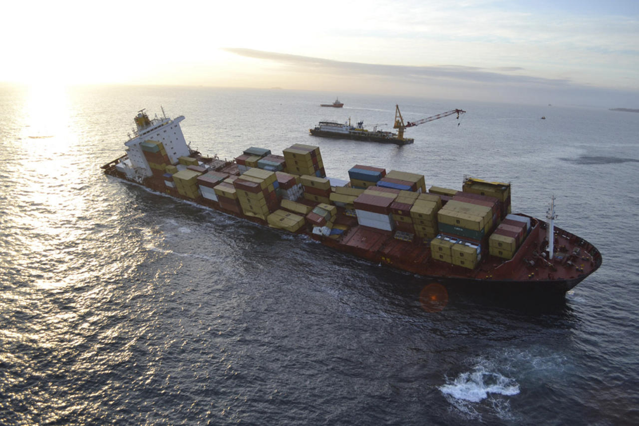 In this Dec. 9, 2011, photo provided by Maritime New Zealand, the cargo ship Rena is hard aground after running full-steam into a well-charted reef off the coast near Tauranga, New Zealand on a calm night on Oct. 5.Australian inspection records show that a cargo ship that ran aground off New Zealand in October had previous safety issues. (AP Photo/Maritime New Zealand, Graeme Brown) EDITORIAL USE ONLY