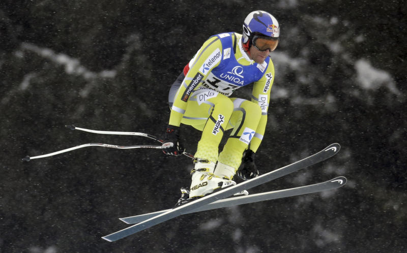 Norway's Aksel Lund Svindal takes a jump during the men's downhill, at the Alpine skiing world championships in Schladming, Austria, Saturday, Feb.9, 2013. (AP Photo/Luca Bruno)