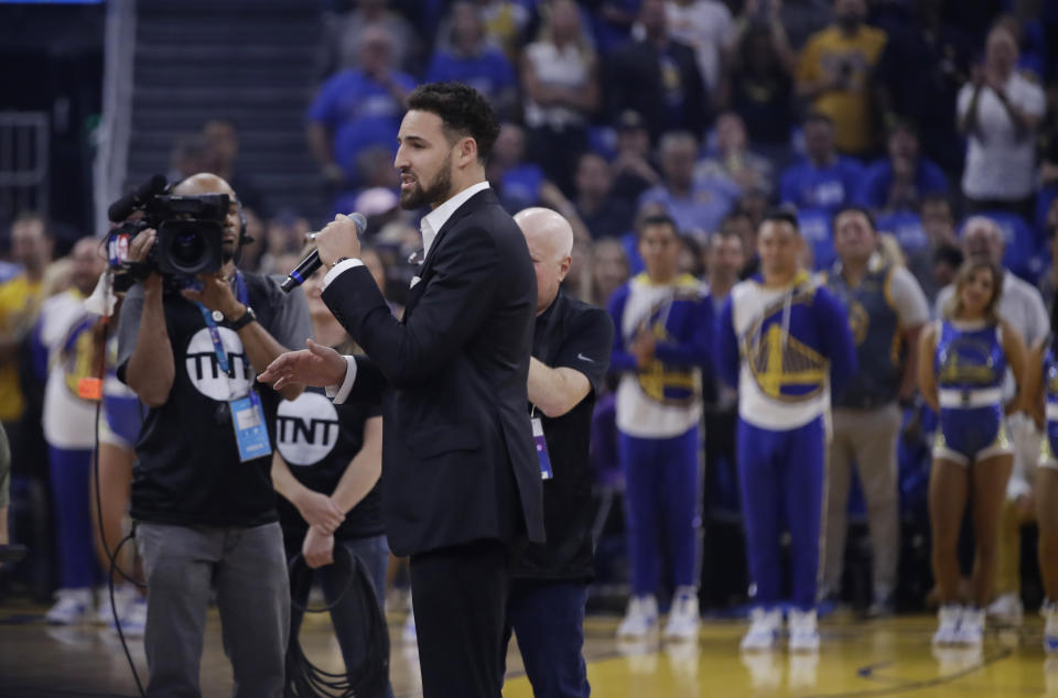 Golden State Warriors' Klay Thompson speaks to fans on the opening day at Chase Center, before the team's NBA basketball game against the Los Angeles Clippers on Thursday, Oct. 24, 2019, in San Francisco. (AP Photo/Ben Margot)