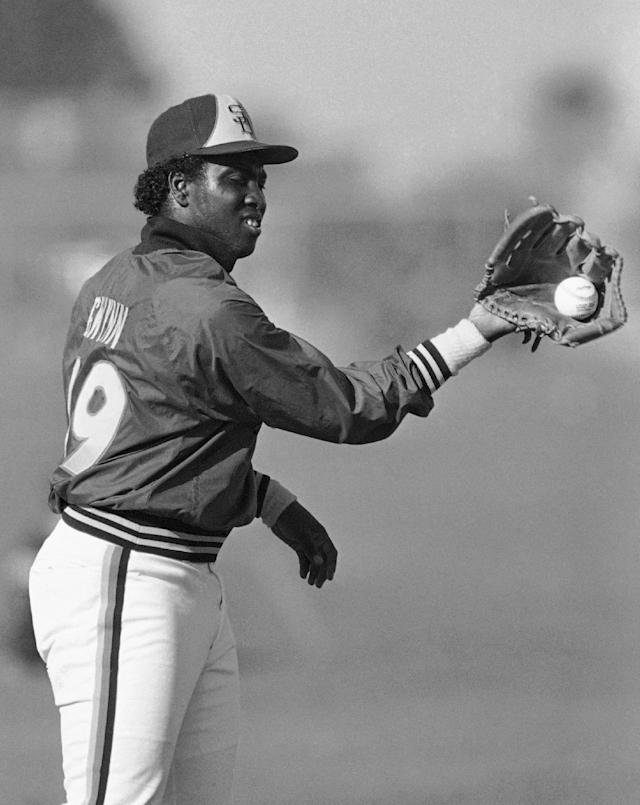FILE - In this March 6, 1985 file photo, San Diego Padres' Tony Gwynn does a twist to make a back hand catch at the teams' spring training camp in Yuma, Ariz. Gwynn, the Hall of Famer with a sweet left-handed swing who spent his entire 20-year career with the Padres and was one of San Diego's most beloved athletes, died of cancer Monday, June 16, 2014. He was 54. (AP Photo/Lenny Ignelzi, File)