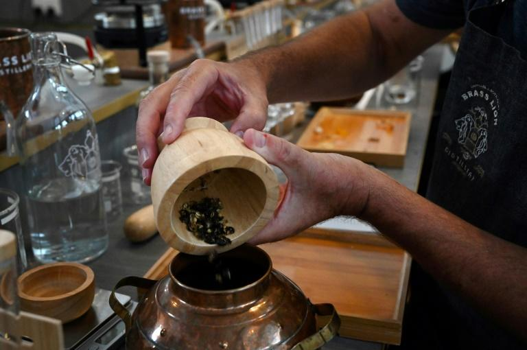 """Gin typically gets its taste predominantly from juniper berries but then """"botancials"""" -- the term for the myriad ingredients used as flavourings -- are added to create a wide range of different varieties (AFP Photo/Roslan RAHMAN)"""
